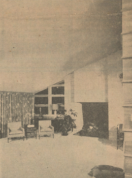 This is a vew of the living room of the Wright house, with dining room talbe in the foreground. Used throughout the hosue are horizontal V-battens which accentuate its long and low lines on the inside as well as the outside.