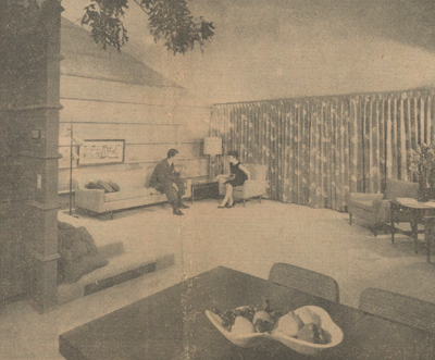 This is the living room of the Wright house, which is at a lower level than other rooms in the house. Note the three broad steps in the foreground, and note, too, the large fireplace in the background.